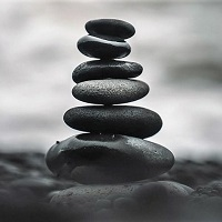 A stack of pebbles balanced in monochrome