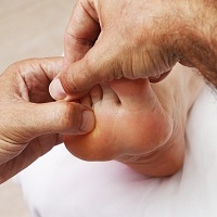 Reflexology treatment on a foot