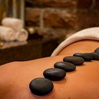 Stones placed along the spine for hot stone massage