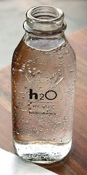 Bottle of water with condensation and h2o written on the label