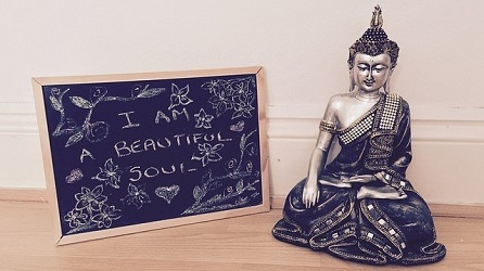 Statuette next to a chalk board reading I am a beautiful soul