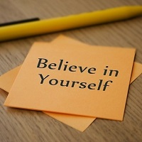 Text on a post it note reading believe in yourself