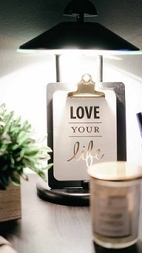 Paper on a clipboard reading love your life