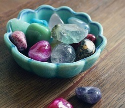 Bowl of various colourful crystals