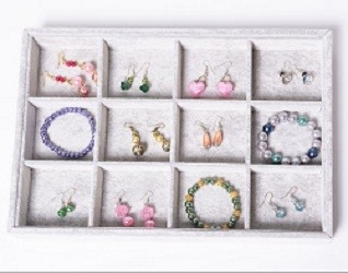 Jewellery box with compartments containing different crystal earrings and bracelets