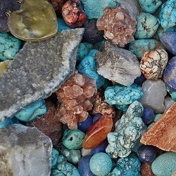 Assortment of different coloured and structured healing stones